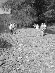 Women at creek bed bw